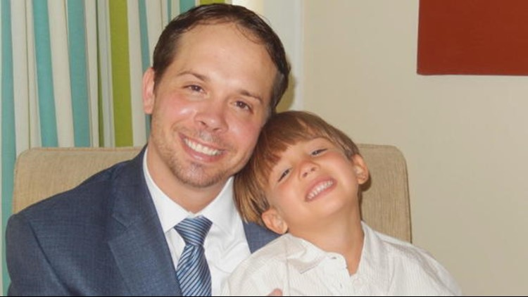 Christopher Brann and his son Nico. (CBS News)