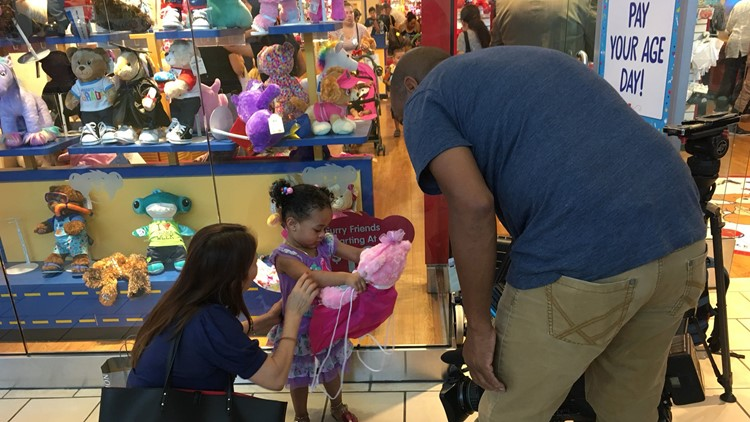 KHOU 11 News Photojournalist Ralph Nickerson surprised this little girl with a Build-A-Bear after security guards refused to let her back in line when she left to use the restroom.