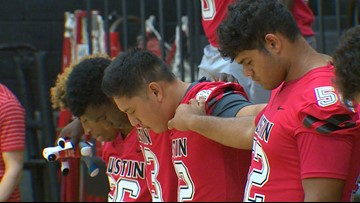 Hundreds gather for vigil, support of injured Austin High School football player