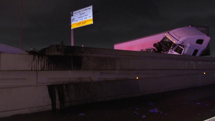 Big rig crash sends debris flying into HPD patrol unit | Katy Freeway reopens after several hours
