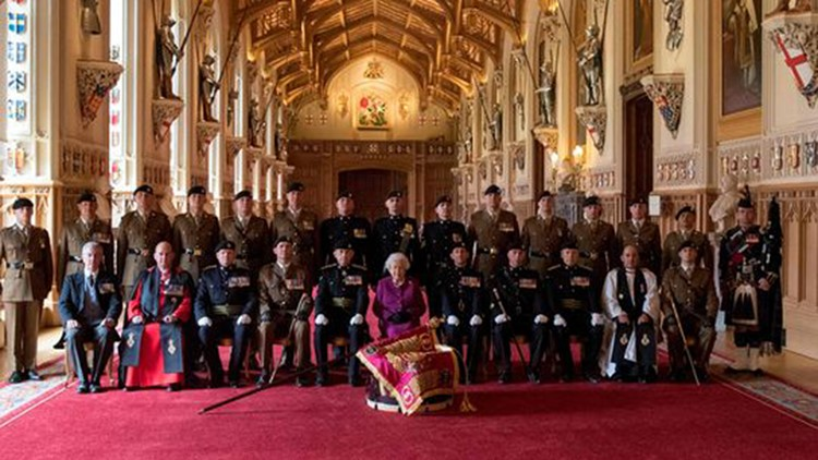 Britain's Queen Elizabeth II, colonel in chief of the Royal Tank Regiment, poses for a photograph after presenting the regiment with their new standard in St George's Hall at Windsor Castle on April 25, 2018. (Photo: Steve Parsons/AFP/Getty Images)