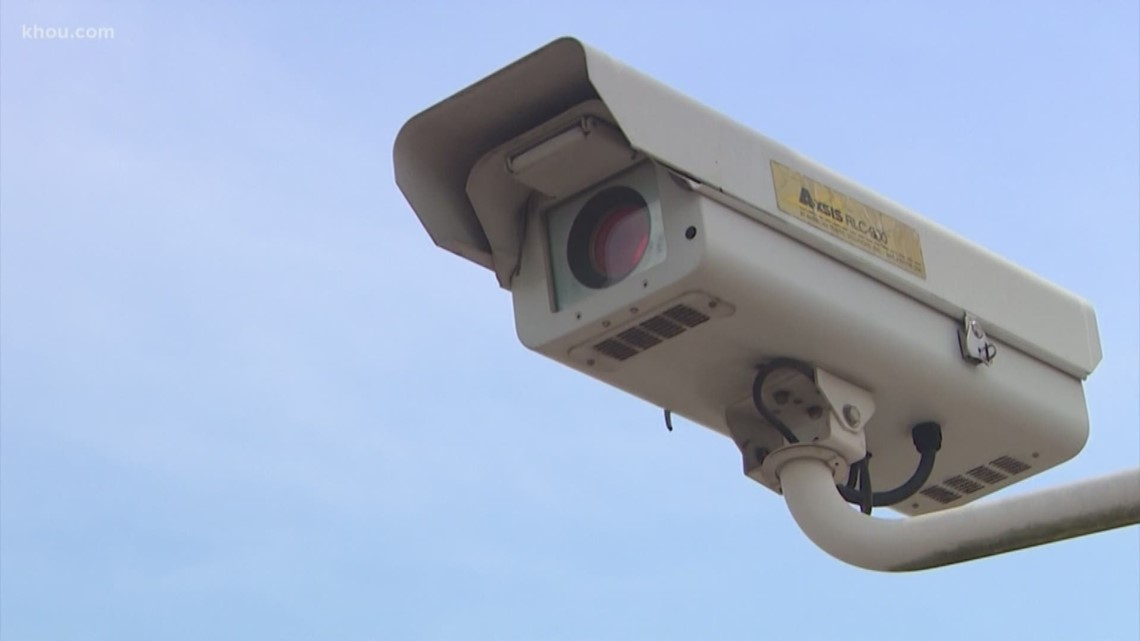 VERIFY: Could unpaid Humble red light camera tickets affect future car registrations?