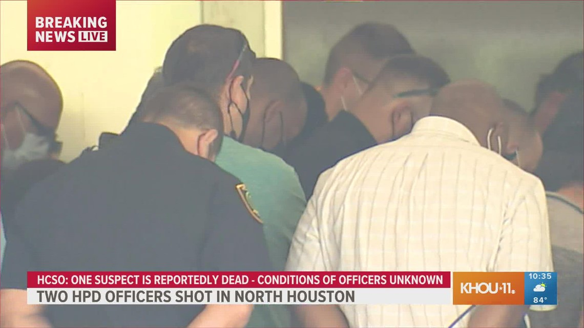 Mayor Turner, Chief Finner and officers pray outside hospital after 2 officers shot