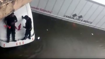 Bystanders use hammer, rope to rescue trucker stranded on 59 feeder with water up to his windshield
