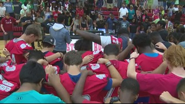 Prayer vigil held for injured Austin High School football player