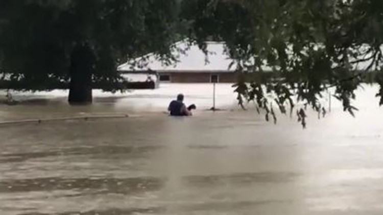 Man braves waist-deep water to rescue animals north of Kingwood