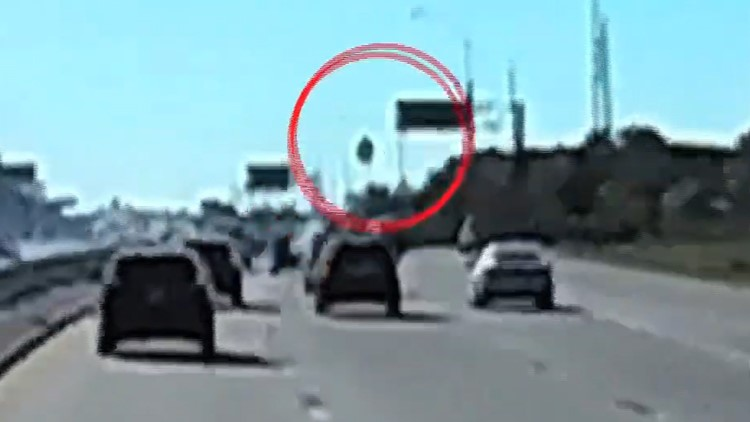 WATCH: Scary moment as flying tire smashes front of pickup on Highway 90