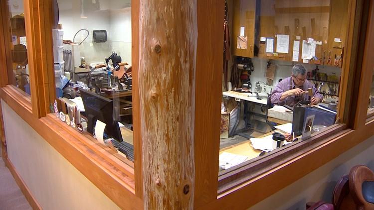 Julio Peña working in his saddle shop