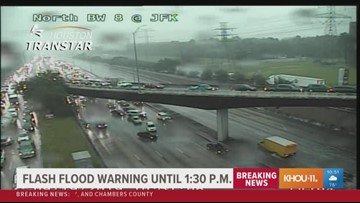 Drivers attempting pass through floodwaters on Beltway 8