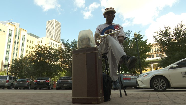 Phillip Flakes has been playing music outside Harris County courthouses for more than 15 years with his simple stage: a worn brown case, a black stool and a tip jar made out of an old milk jug.