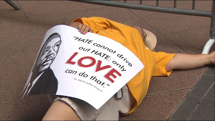"""A protester on the ground during the """"die in"""" protest in DC on Tuesday."""