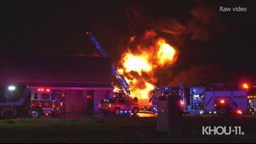 Raw: Large flames shoot from fire outside Houston-area business
