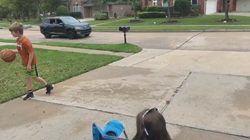 Cypress neighborhood holds drive-by birthday party for little girls