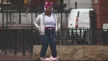 Woman caught dancing in the rain at bus stop