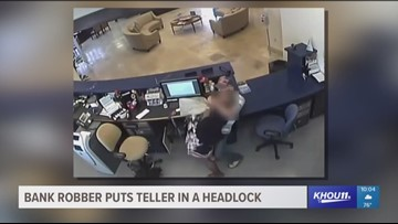 Bank robber puts teller in a headlock