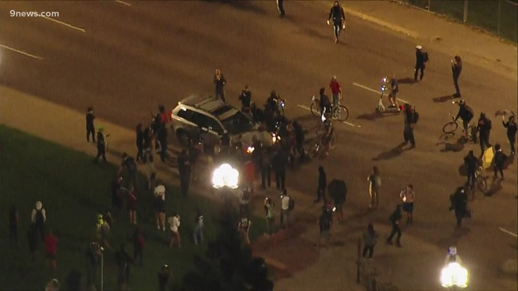 Video shows vehicle driving through crowd as protesters gather in Denver after decision in Breonna Taylor case