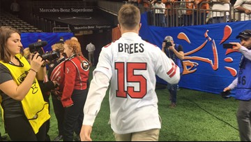 Longhorns' Sam Ehlinger wears Drew Brees Westlake HS jersey prior to Sugar Bowl