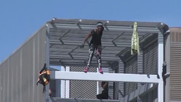 'Statue of Liberty climber' spotted in Austin climbing Southwest Key building in protest