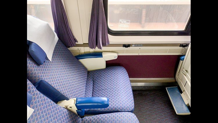 Power outlets are available at each seat on long distance Amtrak trains. (Photo by Summer Hull / The Points Guy)
