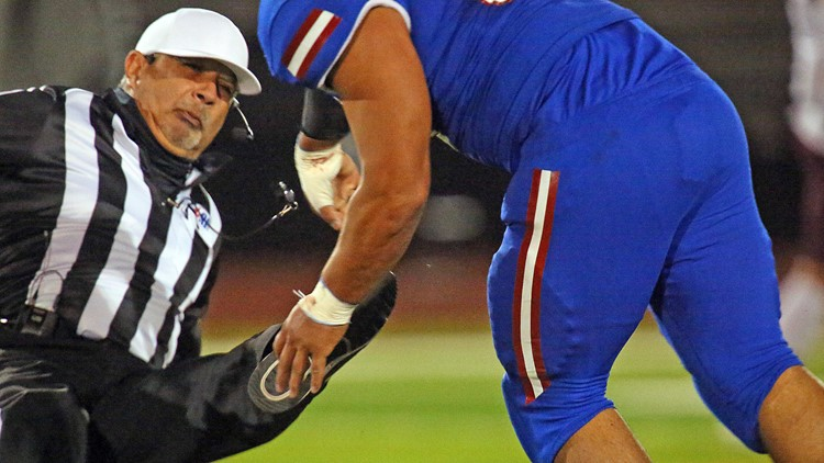Texas high school football player who body-slammed referee charged with assault