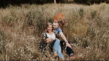Deer photobombs Michigan couple's engagement photos