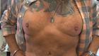 More men turning to plastic surgery, losing 'dad bod'