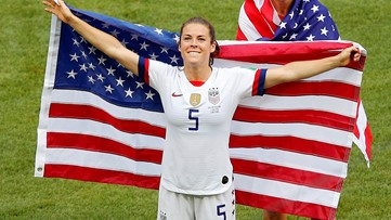 Kelley O'Hara wins over the internet with US flag rescue, post-game kiss, locker room celebration